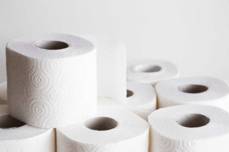 White toilet paper rolls on the gray background. Hygiene concept.