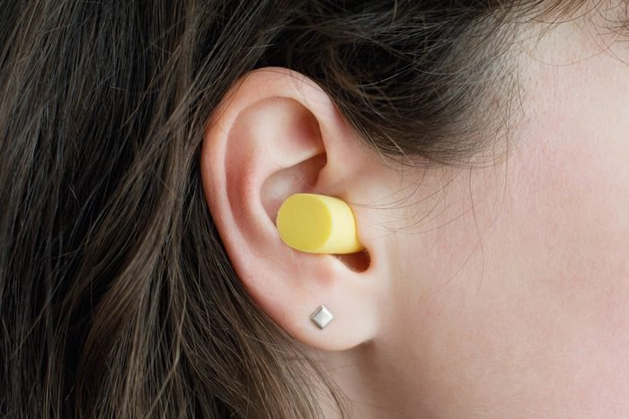 Women wearing an ear plug.