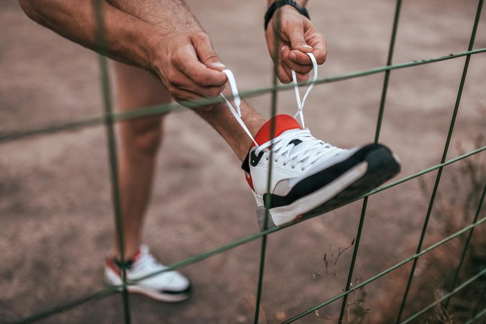 person tying their sneaker