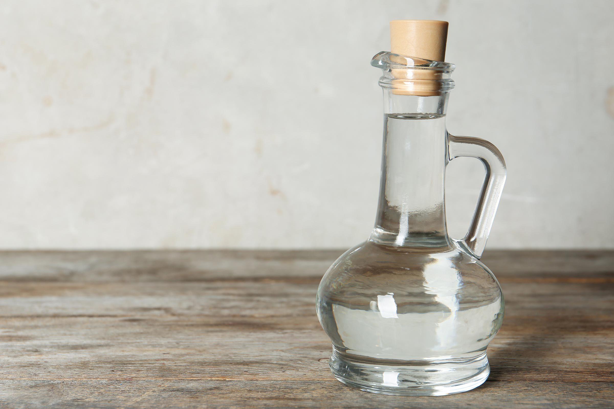 Glass bottle of white vinegar.