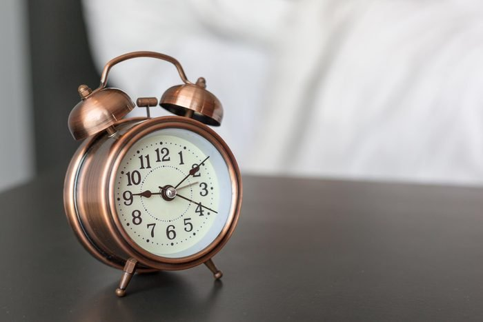 alarm clock on a bedstand
