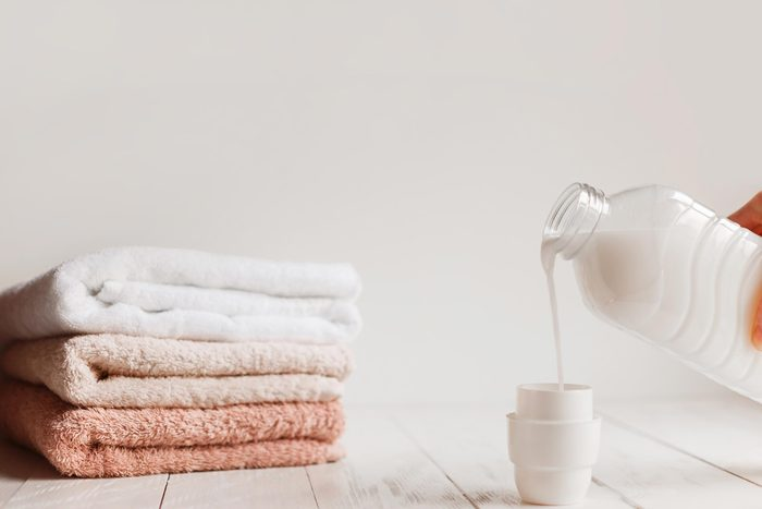 laundry detergent and folded towels