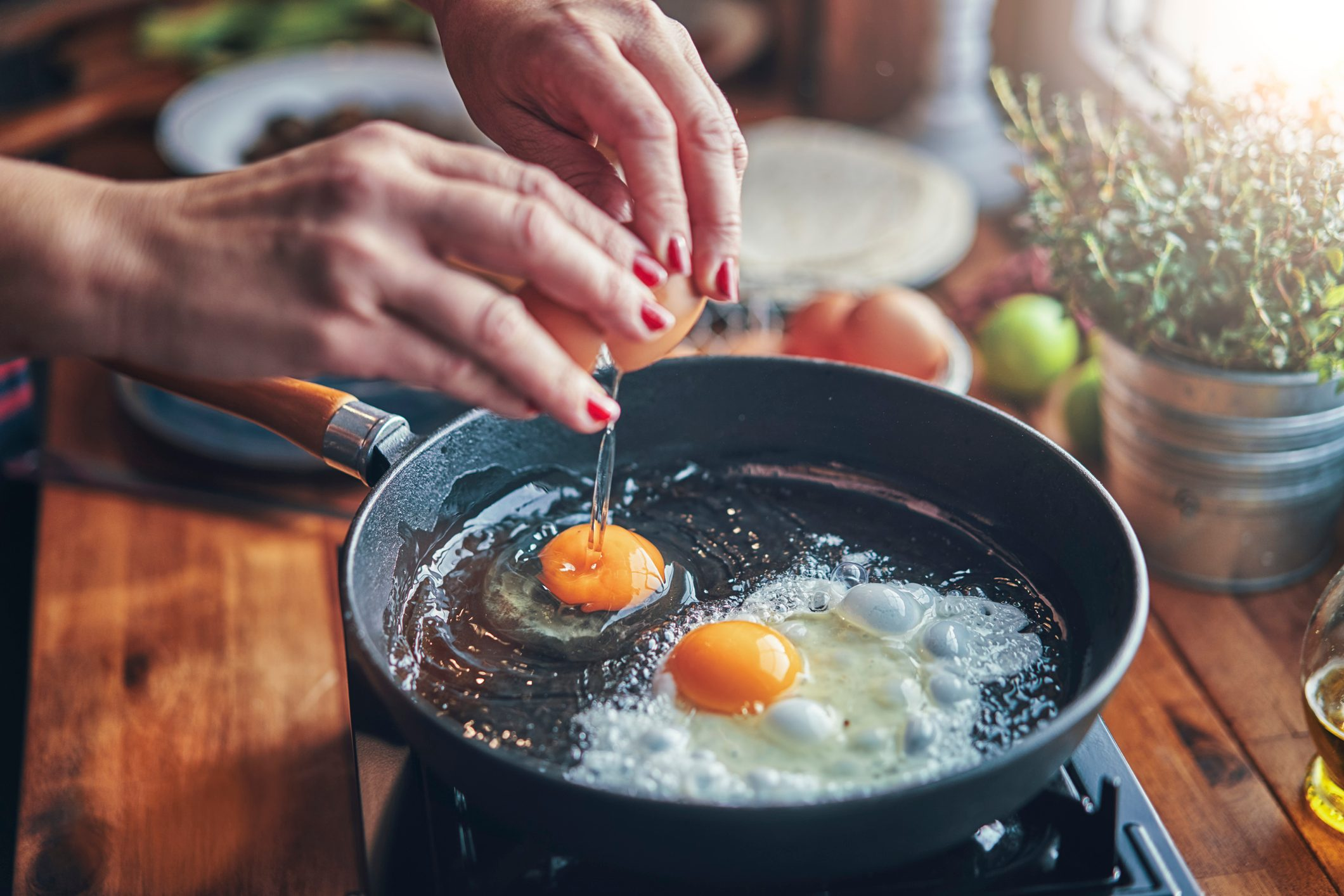 frying two eggs in a pan