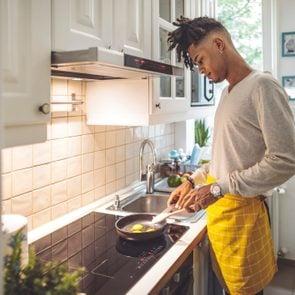 man making breakfast in kitchen
