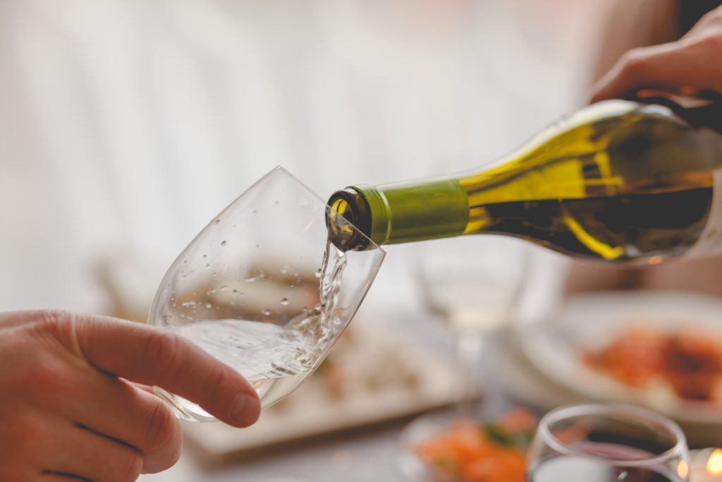 close up of pouring a glass of white wine