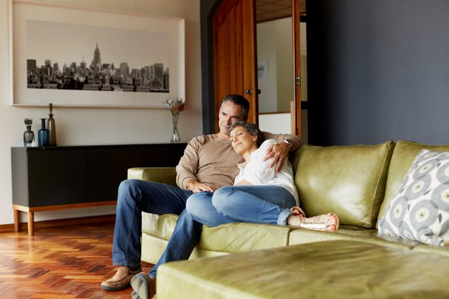 older couple sitting on the couch together at home