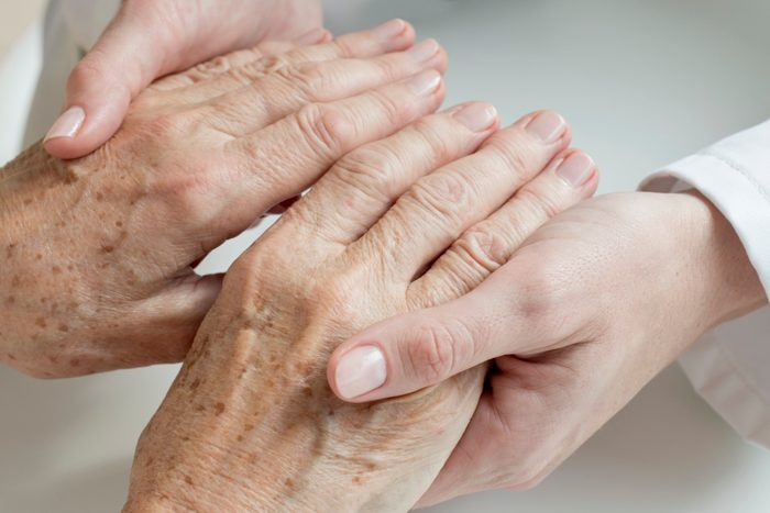 close up of doctor examining senior patient's hands