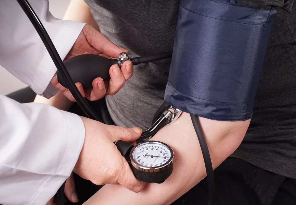 Patient gets Blood pressure check up by the Doctor