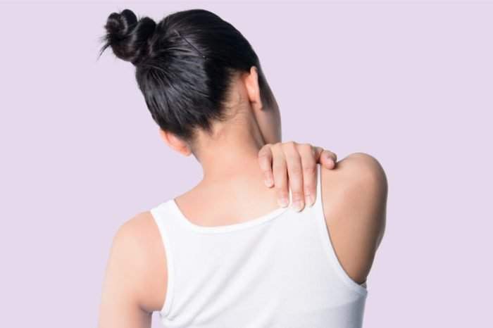 woman upper back neck pain