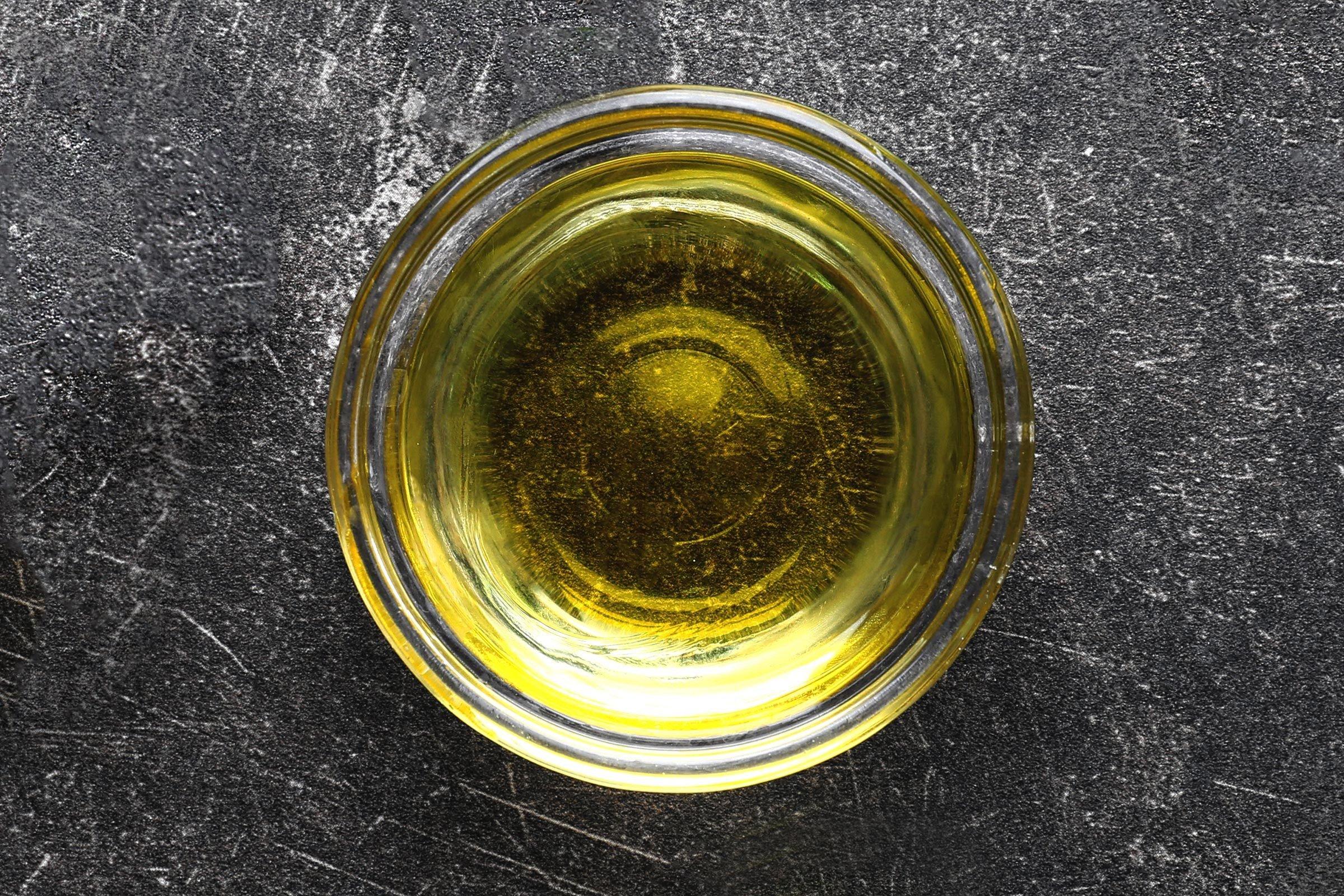 Glass bowl of light olive oil
