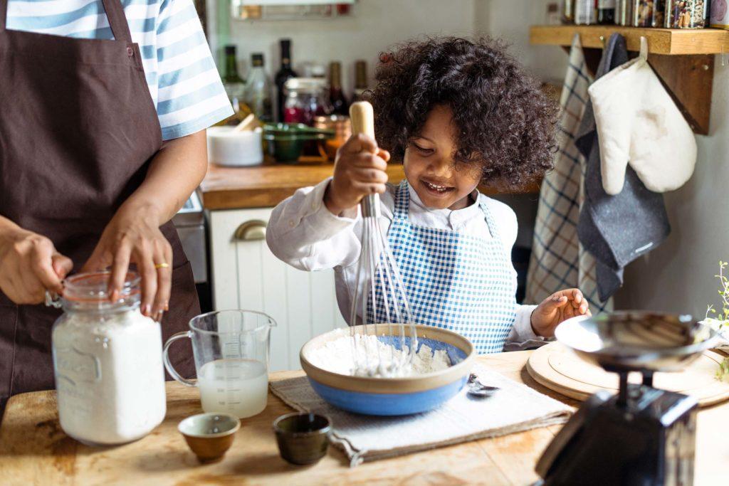 little kid making mess in kitchen