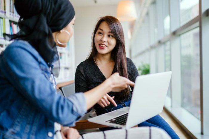 women talking office