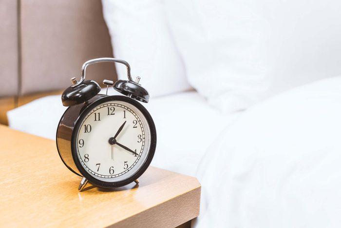 alarm clock on a night table