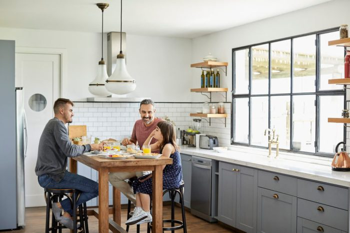 family eating together in kitchen