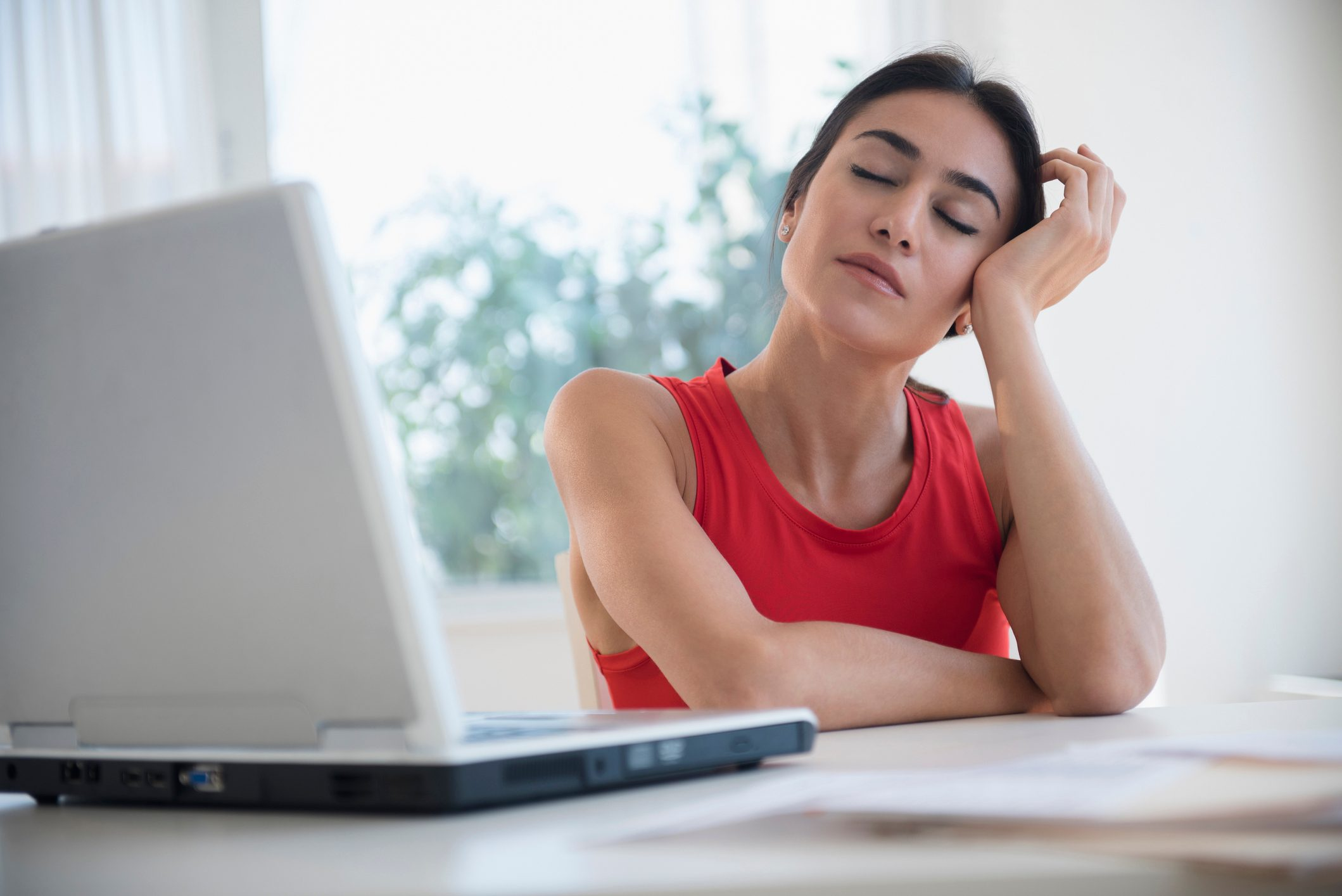 fatigued woman working