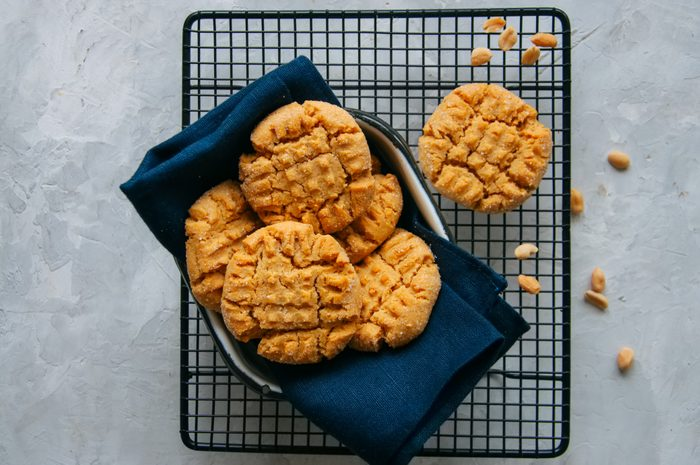 Peanut butter cookies in a dish and on a wire rack