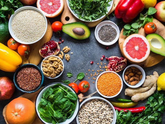 Fresh raw  ingredients for healthy cooking.  Vegetables, fruit, seeds, cereals, beans, spices, superfoods, herbs. Clean food. Top view. Diet or vegetarian food concept. Copy space