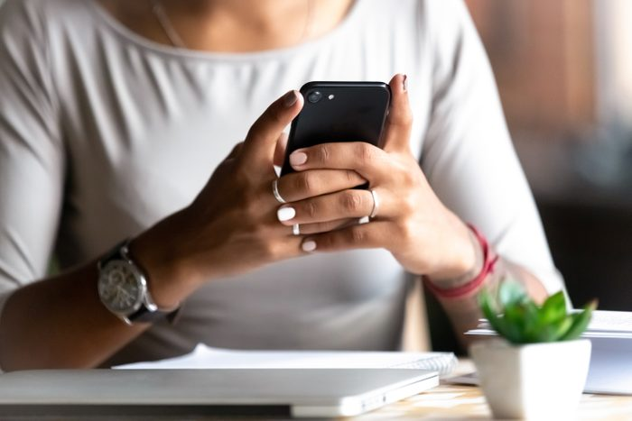 Close up woman holding smartphone
