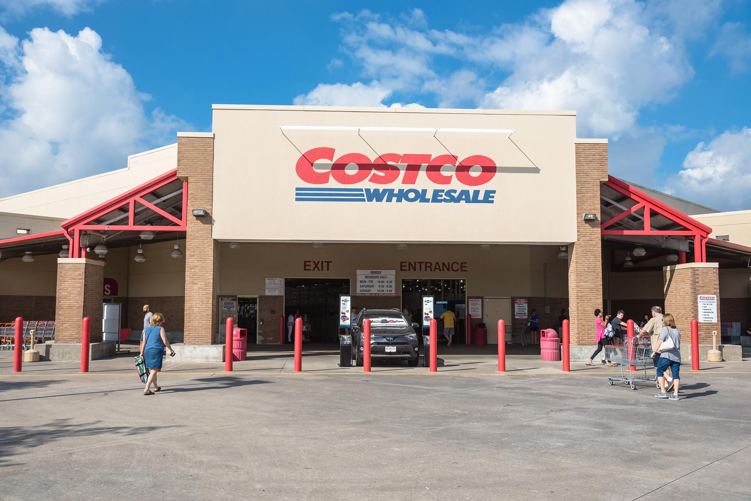 shoppers outside a costco store