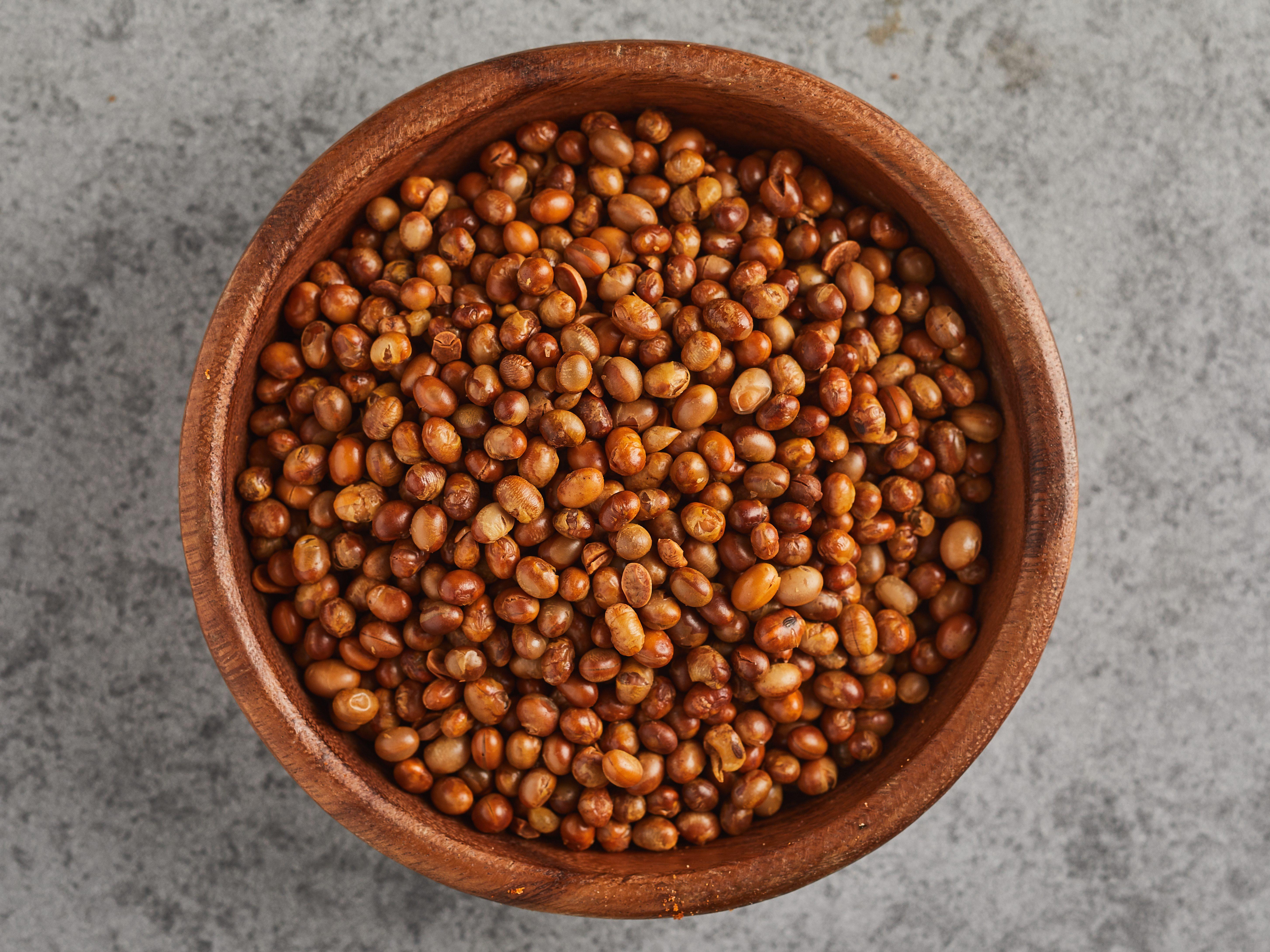 Wooden bowl full of soy beans