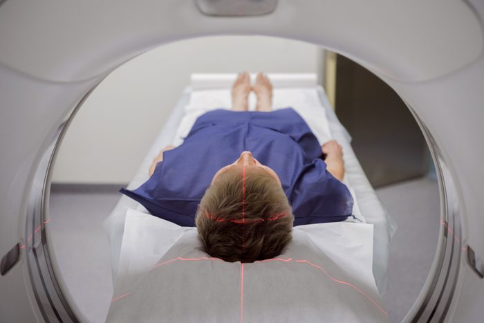person laying in medical machine getting a brain scan