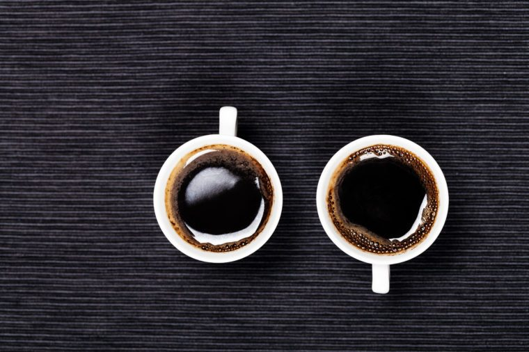 two cups of coffee on a black background