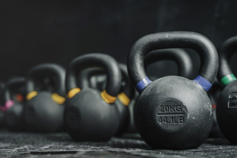 Kettlebells equipment on dark backgroud at the crossfit gym. Sport concept. Copy space