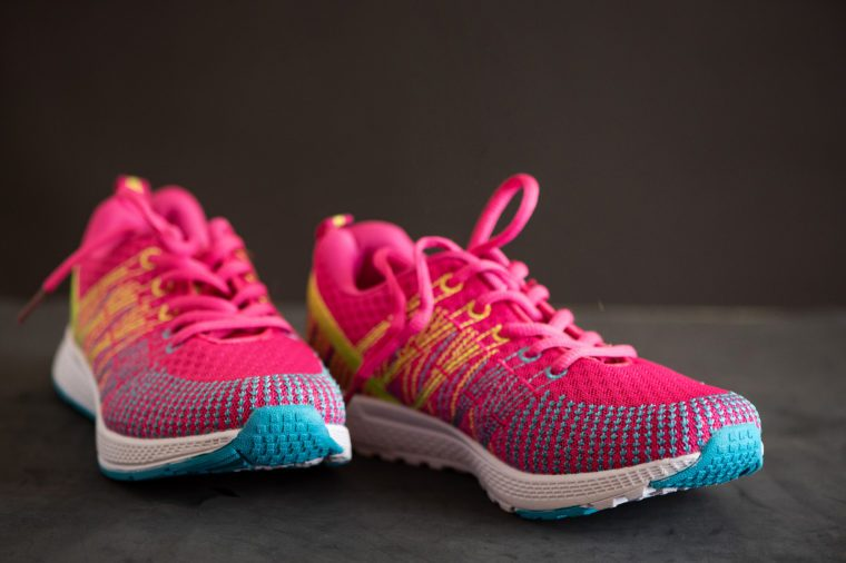 Pink sport shoes. Sneakers on a dark background. Side view.