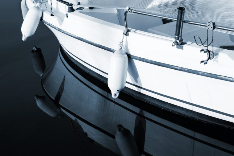 A close-up of a yacht in Antibes, France. Blue tone, copy space.