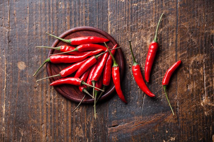 hot chili peppers on wooden background