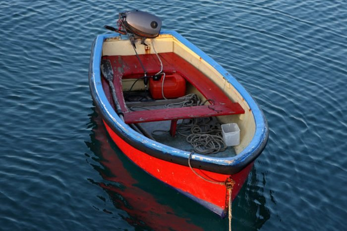 A small red boat at dusk.