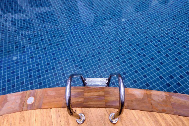 Pool ladder in swimming pool .