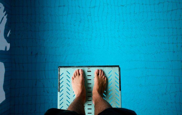 standing on springboard