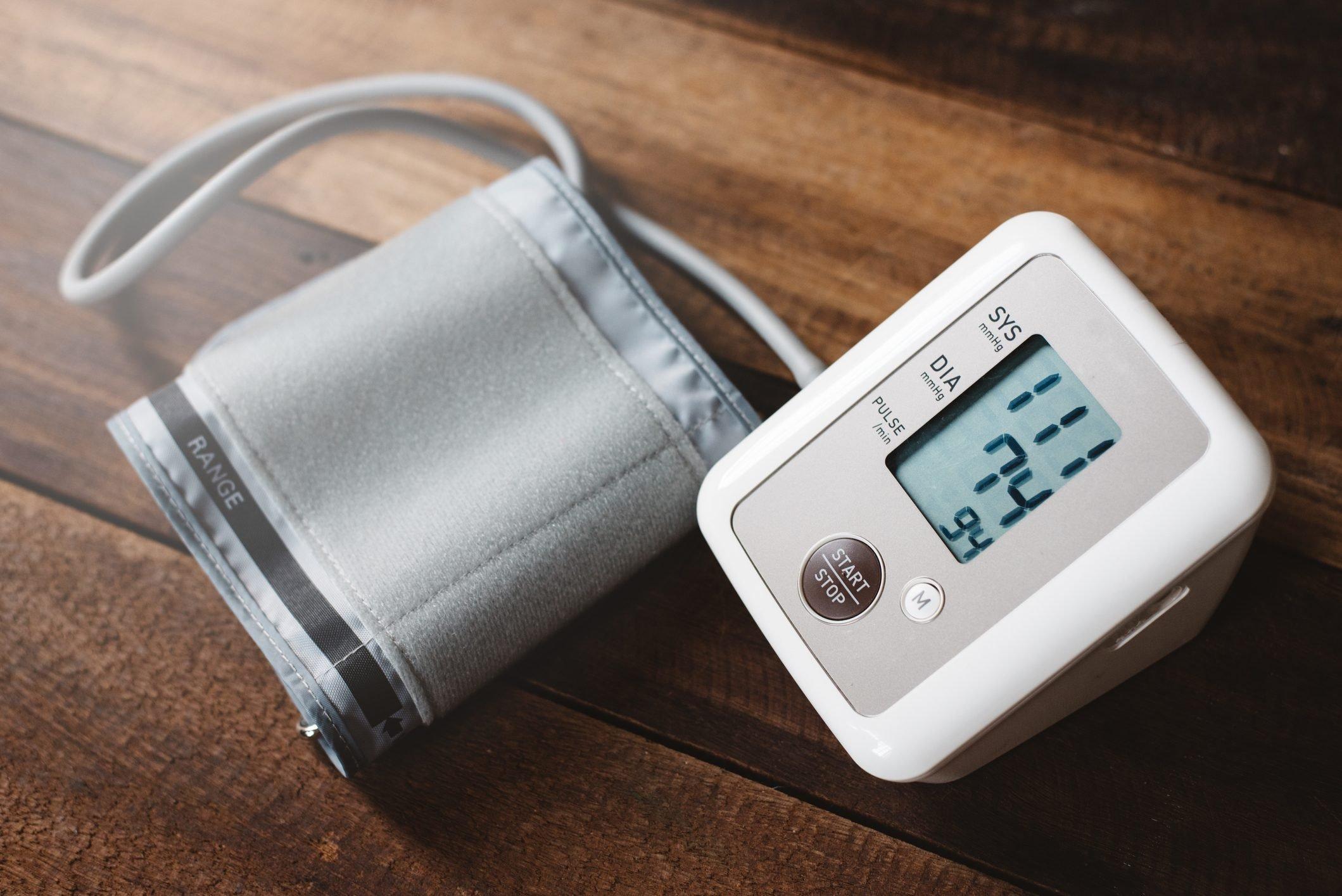 blood pressure machine on wood table