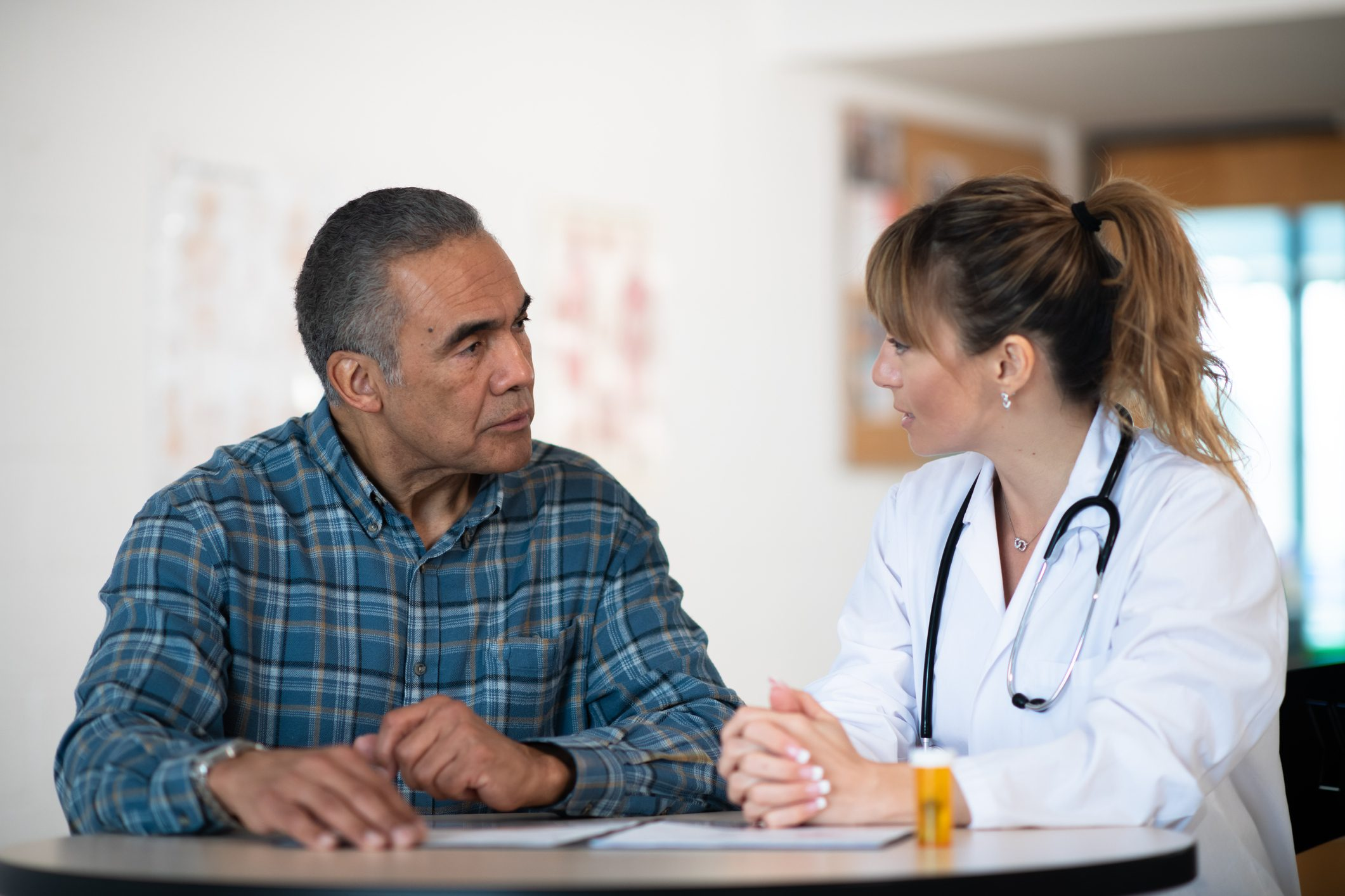 female doctor talking with male patient