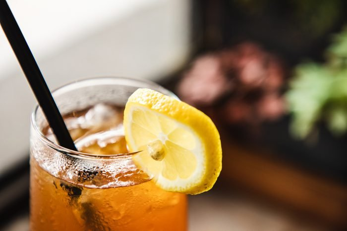 close up of glass of iced tea with lemon