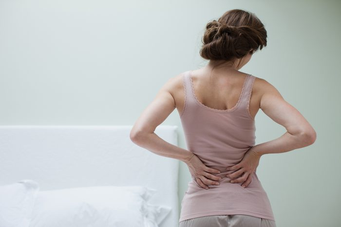 rear view of woman with aching back