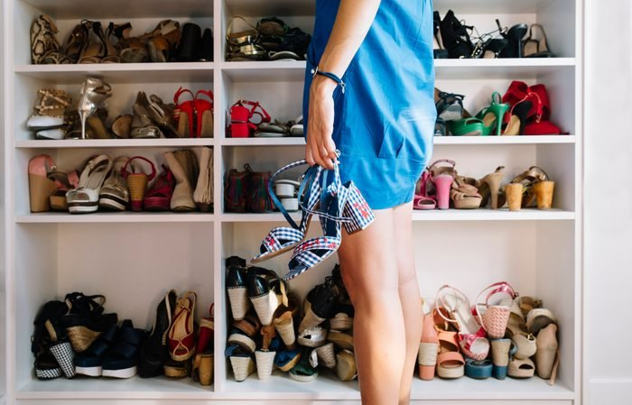 woman looking at her shoe collection