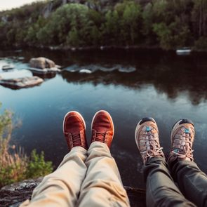 boots overlooking Mountain View lake love couple hiking mental health