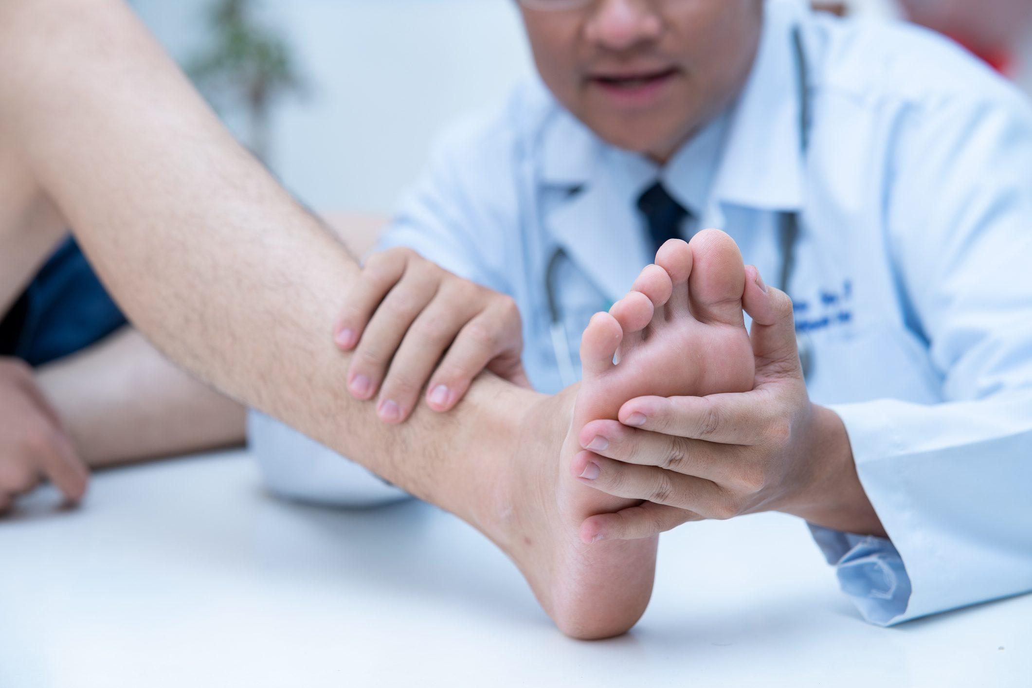 doctor examining patient's foot