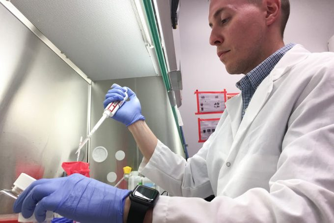 Jacob Yount conducts lab research at The Ohio State University College