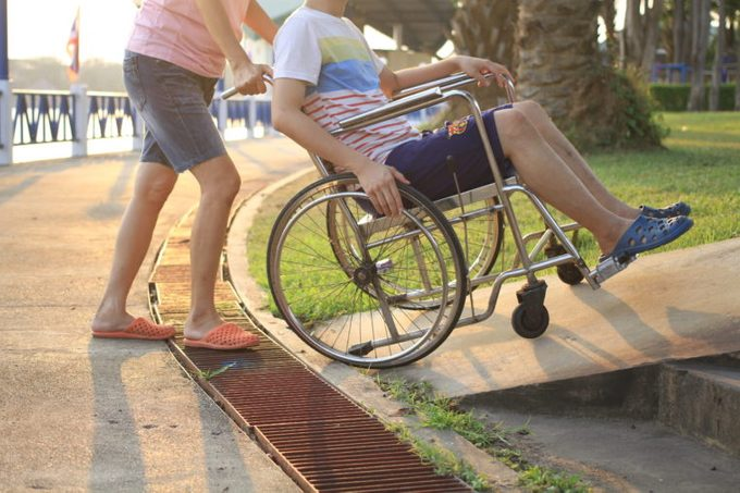 helping disabled person wheelchair help disability