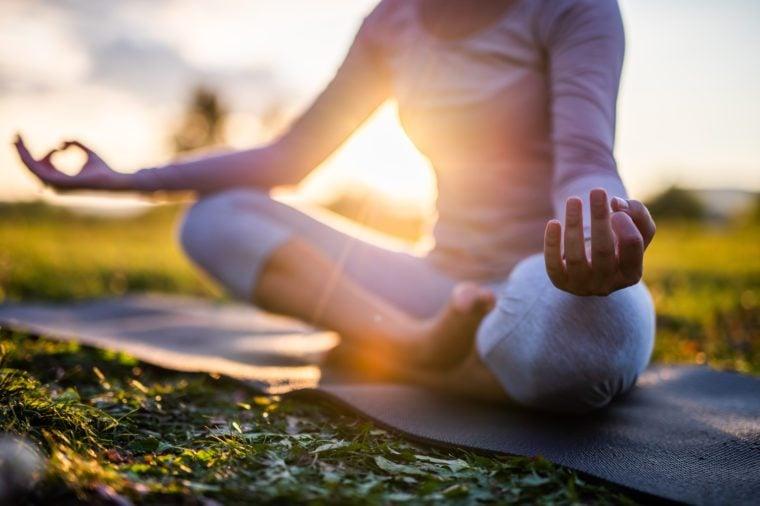 yoga meditation at sunset or sunrise
