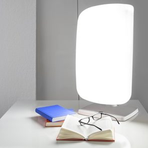 light therapy lamp on desk
