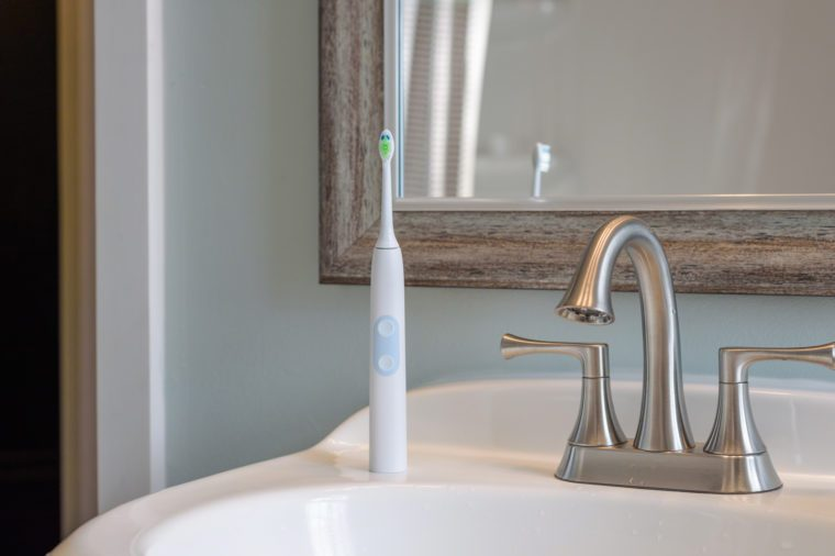 electric toothbrush in bathroom