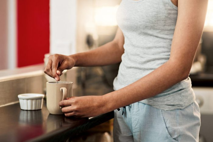 woman making herself a cup of coffee