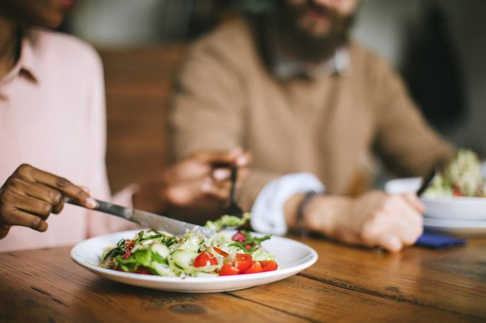 couple eating salad for dinner