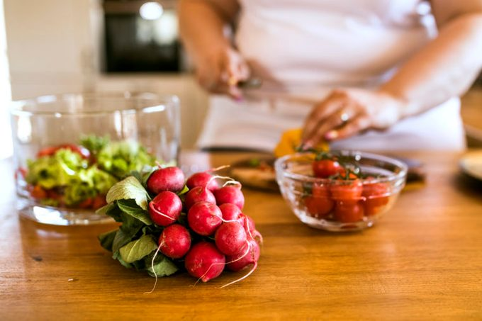 plant based diet preparing food in kitchen