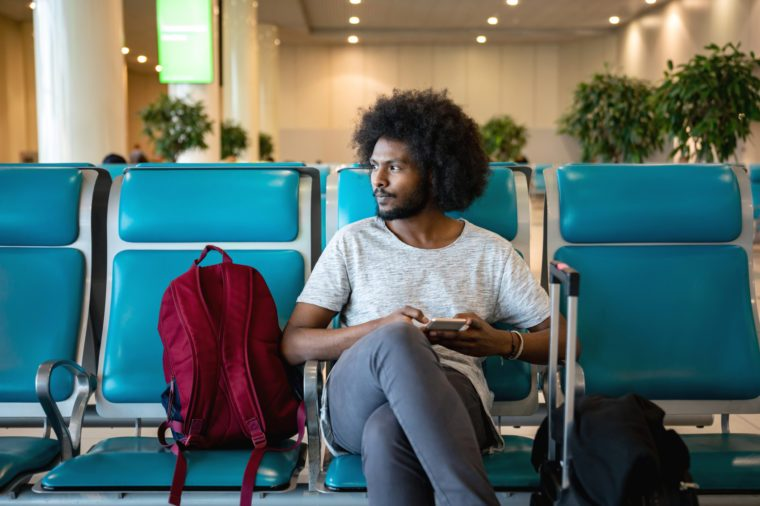 man sitting in airport traveling