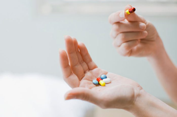 woman taking daily vitamins